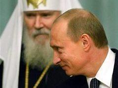Владимир Путин и Алексий II на саммите религиозных лидеров. Фото AFP