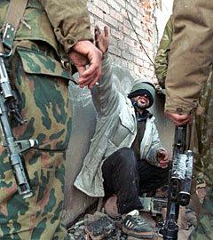 Пленный боевик. Грозный, 2000 год. Фото (c)AFP