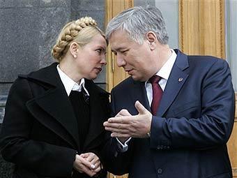 Юлия Тимошенко и Юрий Ехануров. Фото AFP