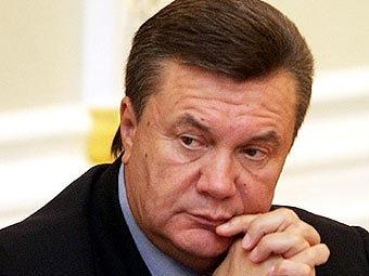 Янукович убил насмерть фотографа