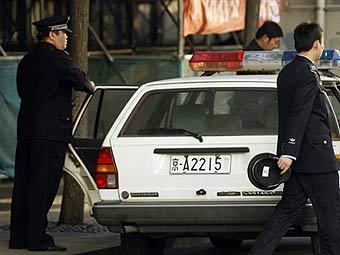 Китайские полицейские. Фото ©AFP