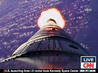 """Кадр видеокамеры, размещенной на корпусе ракеты-носителя """"Арес-I-X"""", переданный CNN"""