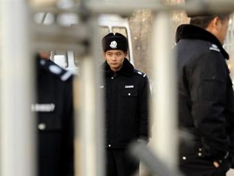 Китайский полицейский. Фото ©AFP
