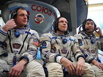 Тимоти Кример, Олег Котов и Соити Ногути. Фото ©AFP