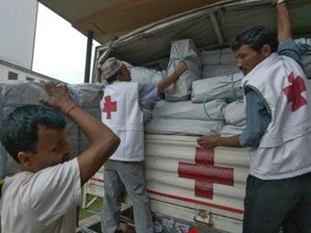Сотрудники Красного Креста в Непале. Фото ©AFP