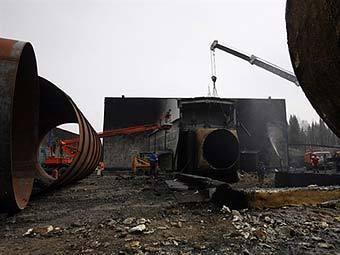 """Последствия взрыва на """"Распадской"""". Фото ©AFP"""