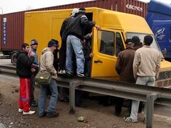 Рабочие-мигранты. Архивное фото ©AFP