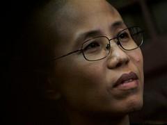 Жену нобелевского лауреата посадили под домашний арест