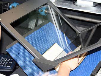 Устройство для оцифровки книг. Фото с сайта cnet.com