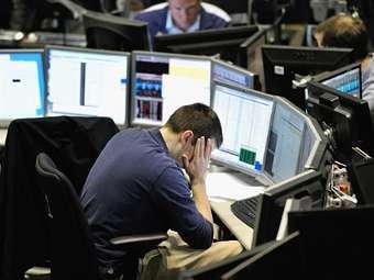 Трейдеры на бирже нередко ориентируются на мнения других участников торгов. Фото ©AFP