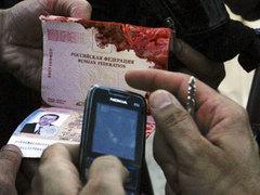 Паспорт одного из убитых в пригороде Кветты. Фото (c)AFP