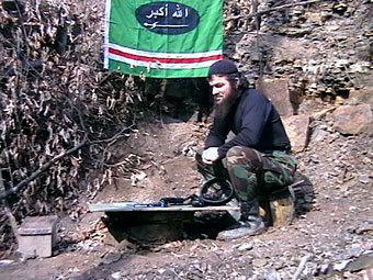 Доку Умаров. Кадр видеозаписи с одного из сайтов северокавказских боевиков