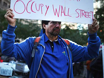 "Участник акции ""Захвати Уолл-стрит"". Фото ©AFP"