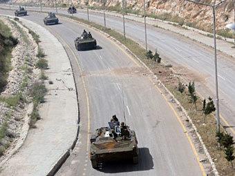 Сирийские город Растан окружили правительственные войска.