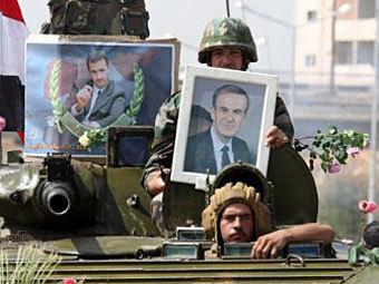 Сирийские военные, лояльные Башару Асаду. Фото ©AFP