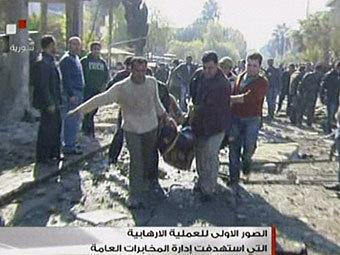 На месте взрыва в Дамаске. Кадр сирийского телевидения, переданный ©AFP