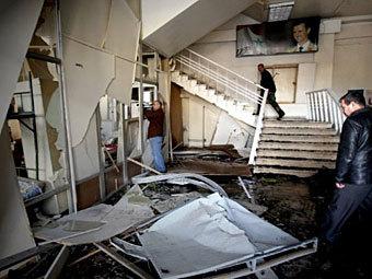 На месте взрыва в Дамаске 23 декабря 2011 года. Фото ©AFP