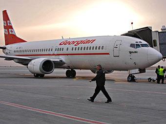 Самолет авиакомпании Georgian Airways в аэропорту Тбилиси. Фото РИА Новости, Давид Хизанишвили