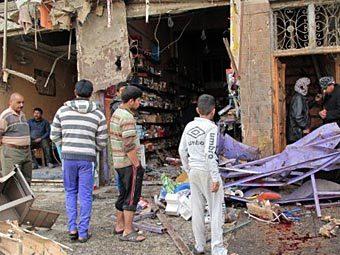 На месте взрыва в Багдаде 22 декабря 2011 года. Фото ©AFP