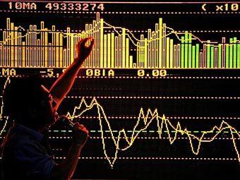 Трейдер на бирже в Шанхае. Фото ©AFP