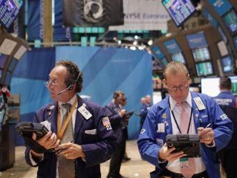 Трейдеры на бирже в Нью-Йорке. Фото ©AFP
