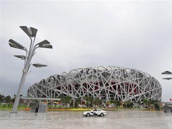Смог над олимпийским стадионом в Пекине. Фото ©AFP