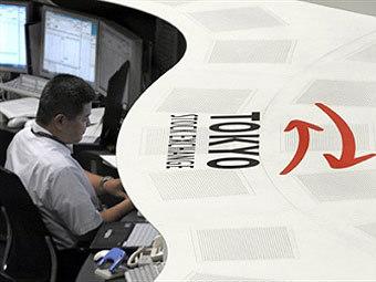 Трейдер на токийской бирже. Фото ©AFP