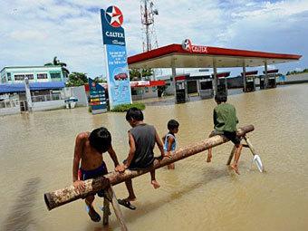 Последствия наводнения на Филиппинах. Фото ©AFP