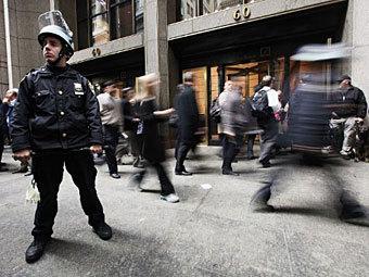 Полицейский на Уолл-стрит. Фото ©AFP