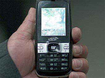 Мобильный телефон из КНДР. Фото пользователя Eric Lafforgue с сайта Flickr