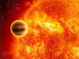 Художественное представление планеты WASP-12b, обращающейся вокруг своей звезды. Изображение ESA/C Carreau