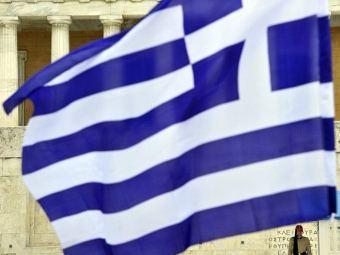 Государственный флаг у парламента Греции. Фото ©AFP