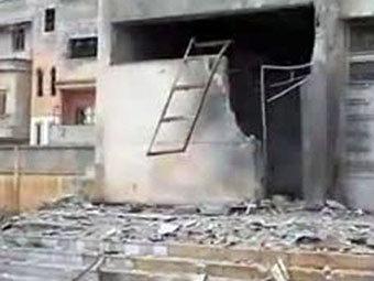 Последствия обстрела в Хомсе. Кадр видеозаписи, переданный ©AFP