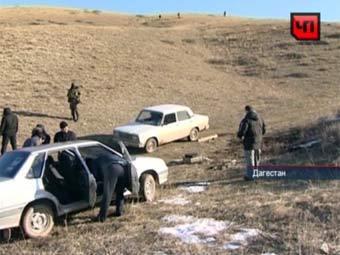 Следователи в районе места убийства охотников. Кадр телеканала НТВ