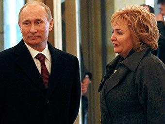 Владимир и Людмила Путины на избирательном участке. Фото Reuters