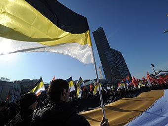 """Колонна националистов на митинге """"За честные выборы"""" 10 марта. Фото РИА Новости, Илья Питалев"""