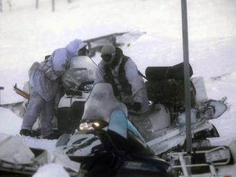 Участники поисковой операции в районе крушения C-130. Фото (с)AP