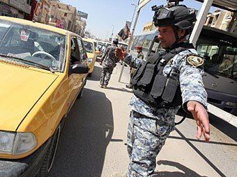 Сотрудник иракских спецслужб в Багдаде. Фото ©AFP