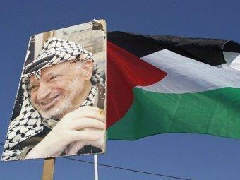 Портрет Ясира Арафата на Западном берегу реки Иордан. Фото ©AFP