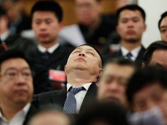 Китайские чиновники. Фото Reuters