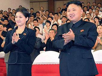 Ким Чен Ын со спутницей. Фото ©AFP
