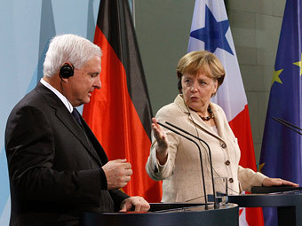 Рикардо Мартинелли и Ангела Меркель. Фото Reuters