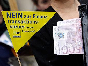 Еврокомиссия разрешила странам ввести налог на финансовые сделки