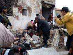 Последствия авиаудара в городе Халфайя. Фото (c)AFP