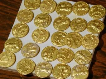 Золотые монеты Фото ©AFP PHOTO / ALI AL-ALAK.