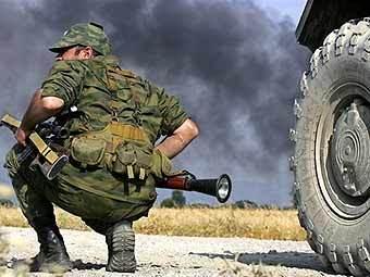 Российский военный в зоне конфликта. Фото AFP