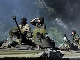 Колонна российских войск в зоне конфликта. Фото AFP