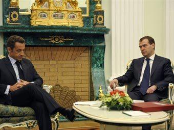 Николя Саркози (слева) и Дмитрий Медведев. Архивное фото AFP